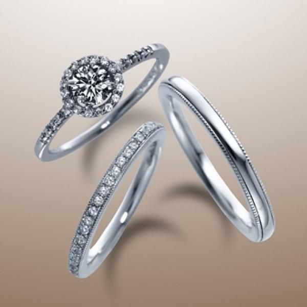 【カオキ ダイヤモンド専門卸直営店】囲みメレの豪華なリングは、細身のアームとのバランスで可憐な女性らしさを。SN-9