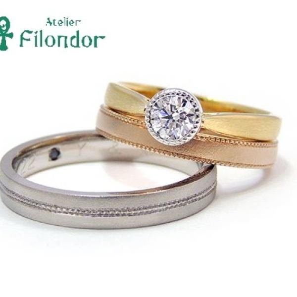 【アトリエフィロンドール】【アトリエ・フィロンドール】ベゼルセッティングのダイアモンドとミル打ち、ゴールドが魅力のエンゲージリング