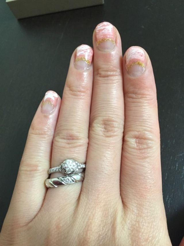 結婚指輪はトルサード一粒ダイヤ、婚約指輪はリアンマルチリング