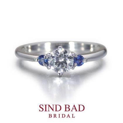 【SIND BAD(シンドバット)】婚約指輪【朝水(あさみ)】朝露を湛えた新緑の光 サファイアをアレンジ。