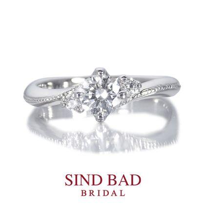 【SIND BAD(シンドバット)】婚約指輪【月星 るな】センターのダイヤは月を 両サイドのダイヤとミル打ちは星を表現